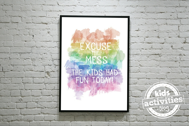 Free Printable Watercolor Art that is framed in a black frame and hung on a wall.