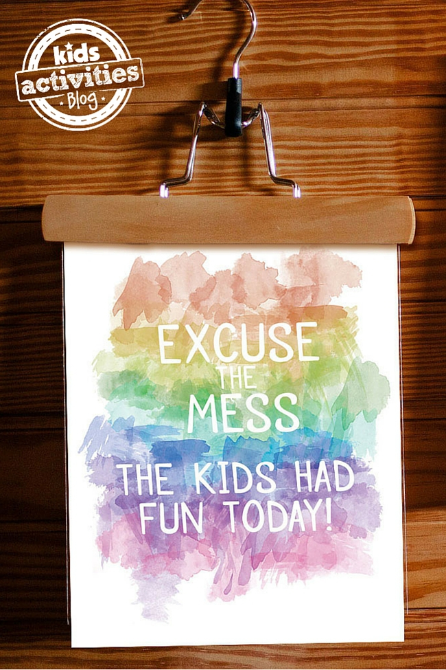 This watercolor printable art with the colors of the rainbow is now suspended by a hanger to warn people of the mess.