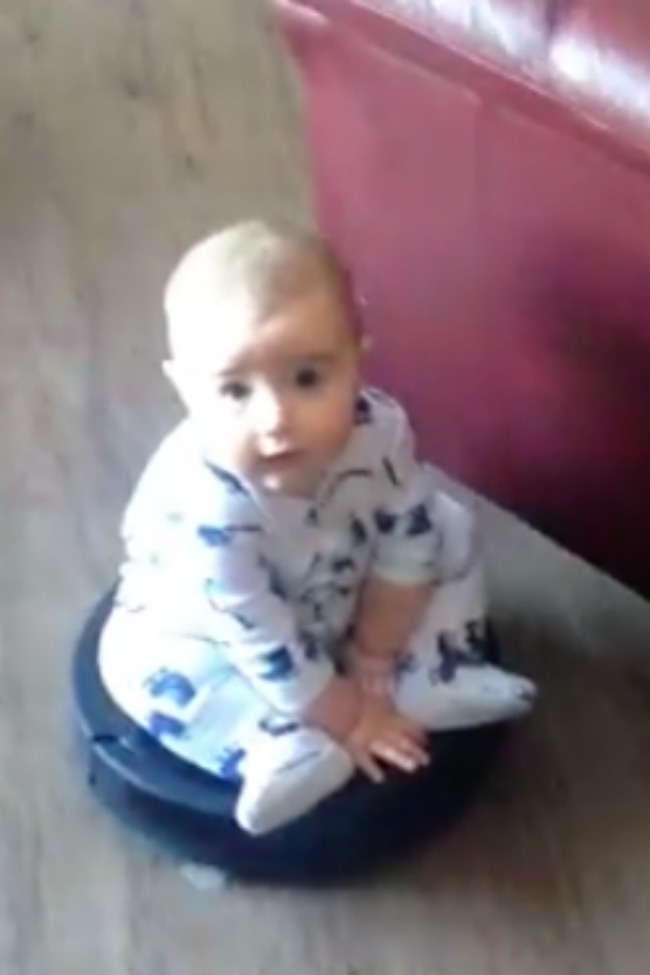 This Baby Rides A Roomba Like A Rockstar!