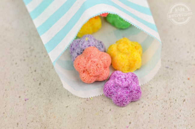 These DIY gifts are perfect for mother's day or other holidays. These Flower fizzy bath bombs are purple, pink, yellow, and green in a white and blue wrapper.