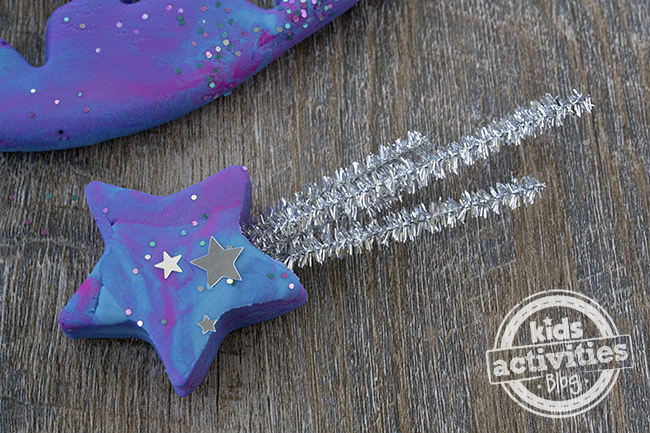 Shooting stars made from galaxy playdough and silver pipe cleaners.