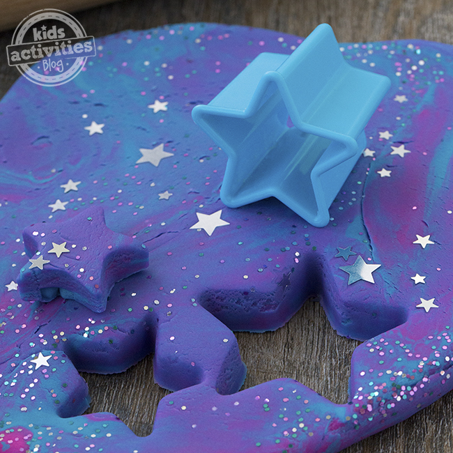 You can use star cookie cutters to cut out stars from your galaxy play-doh