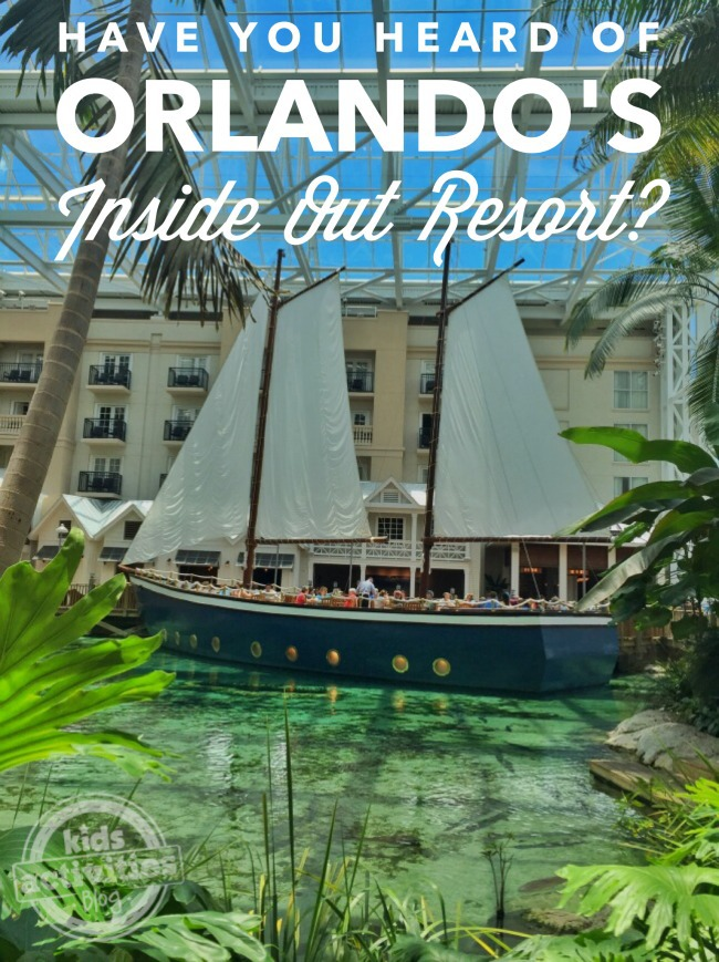 Gaylord Palms Resort with a boat, fauna, and water.