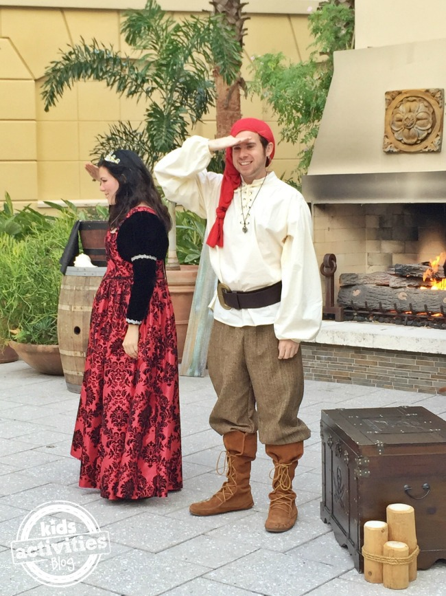 Gaylord Palms Summer Orlando princess and pirate story times by a roaring fire and chest.