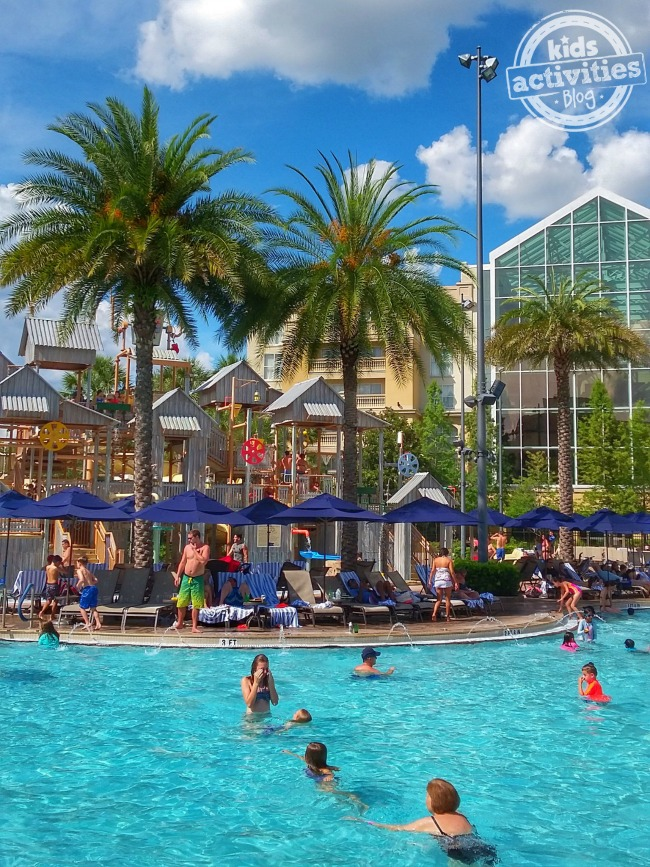 Gaylord Palms Water Park with lots of people swimming, palm trees, and cabanas.