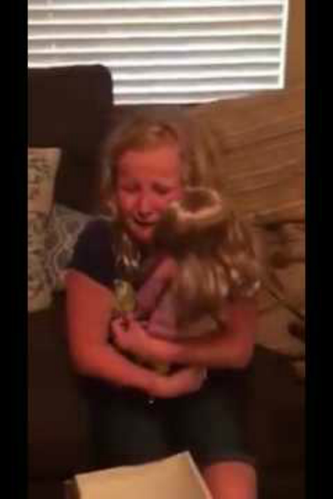 This little girl receiving a doll with a prosthetic leg will make you cry happy tears!