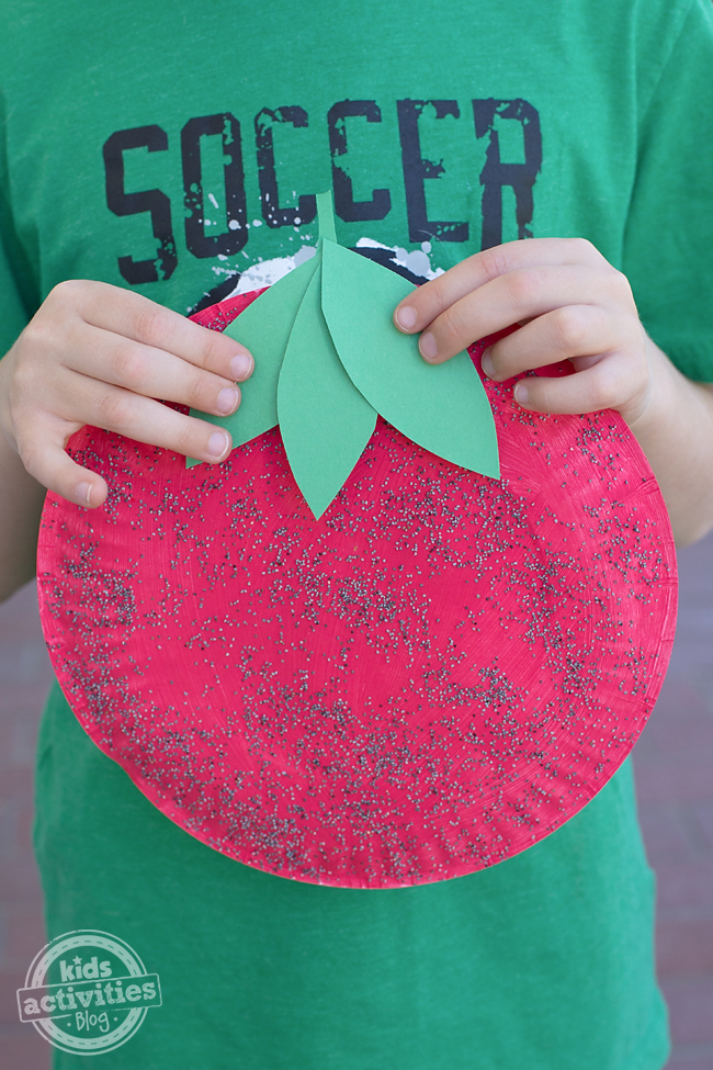 This sweet paper plate strawberry craft is perfect for summer and fun for kids of all ages.