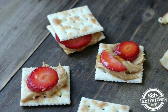 5 Back to School Afternoon Snack Ideas - crackers with peanut butter and strawberries