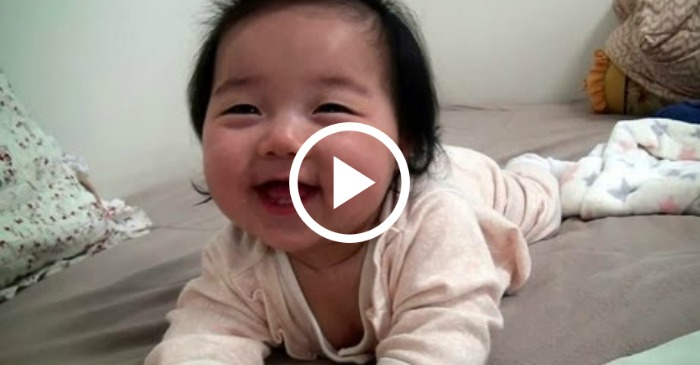 baby wakes up smiling