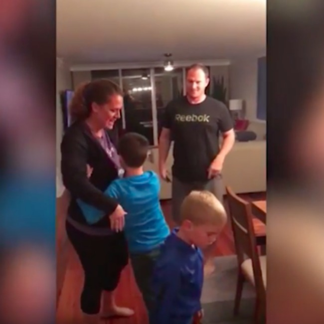 screenshot from video of parents telling kids that they have a new sibling
