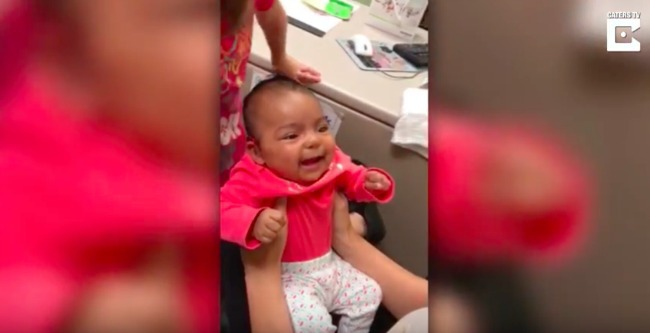 screenshot of video where baby is smiling