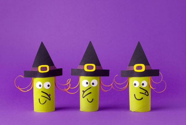 A trio of witches made out of toilet paper rolls.