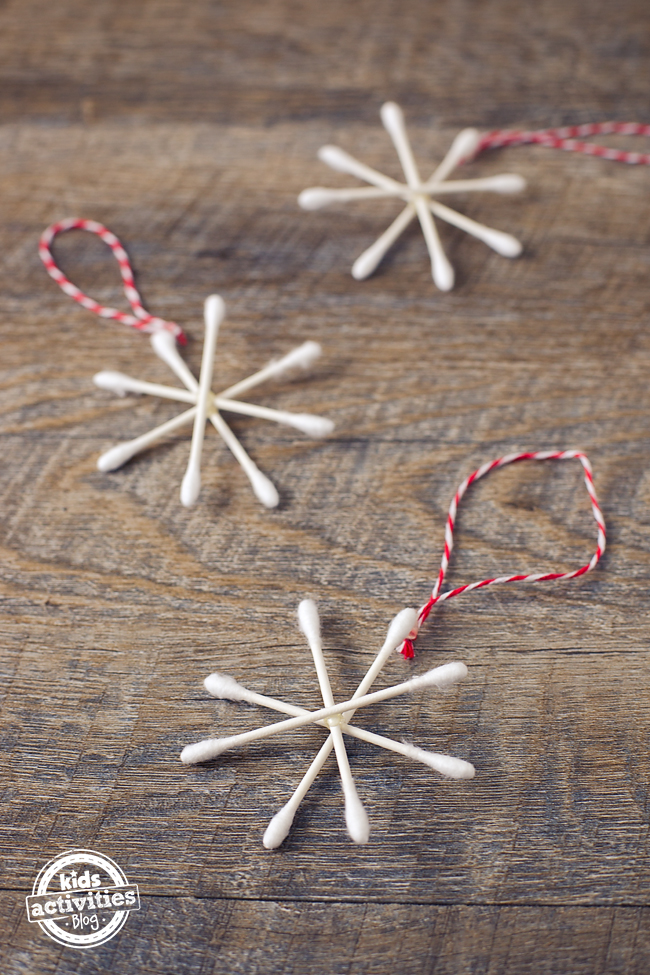 make a q tip snowflake step 3 - add the string to hang