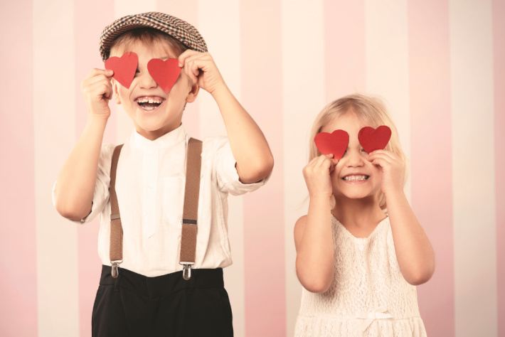 Valentine Photo Shoot with kids - Kids Activities Blog - two kids with hearts over eyes