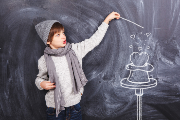 Valentine Photoshoot ideas with kids - boy pulling heart out of magic top hat