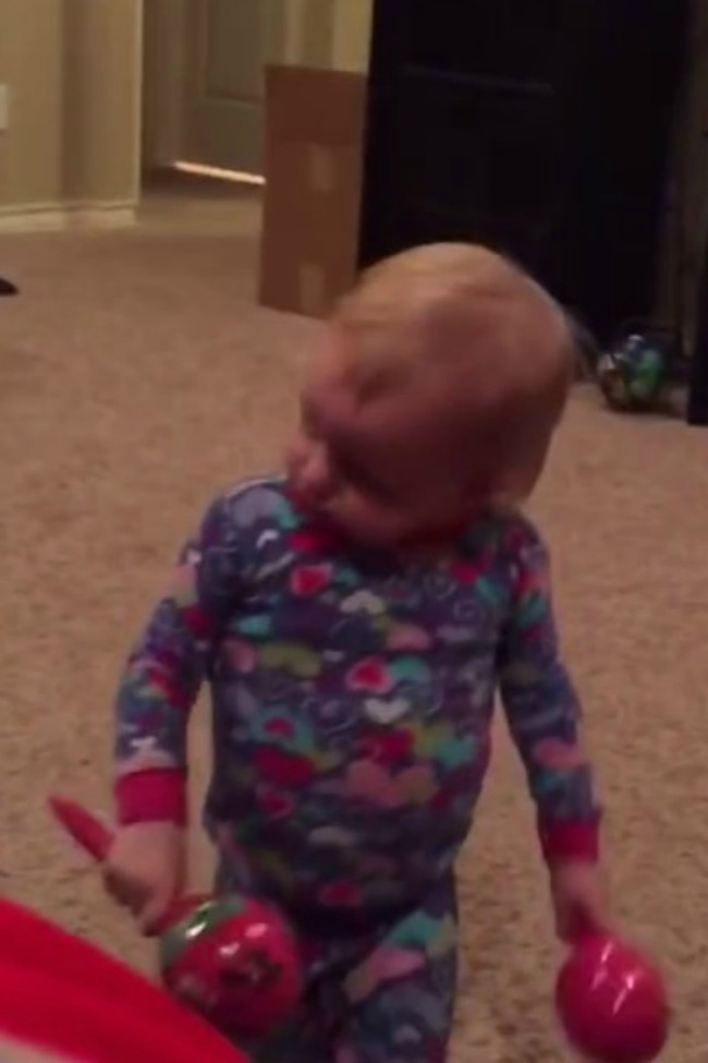 Toddler Tells Her Dad 'No, No,' When He Tries To Play With Her Maracas