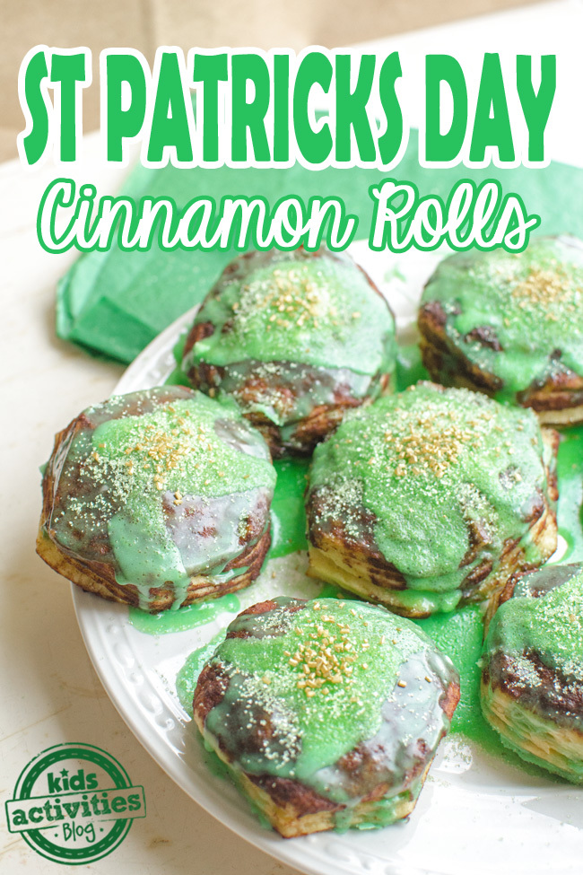 St. Patrick's day snacks with green and gold cinnamon rolls.