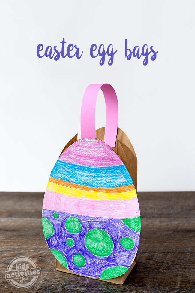 Easter craft making an easter egg bag that has pink, blue, orange, yellow, pink, purple, and green