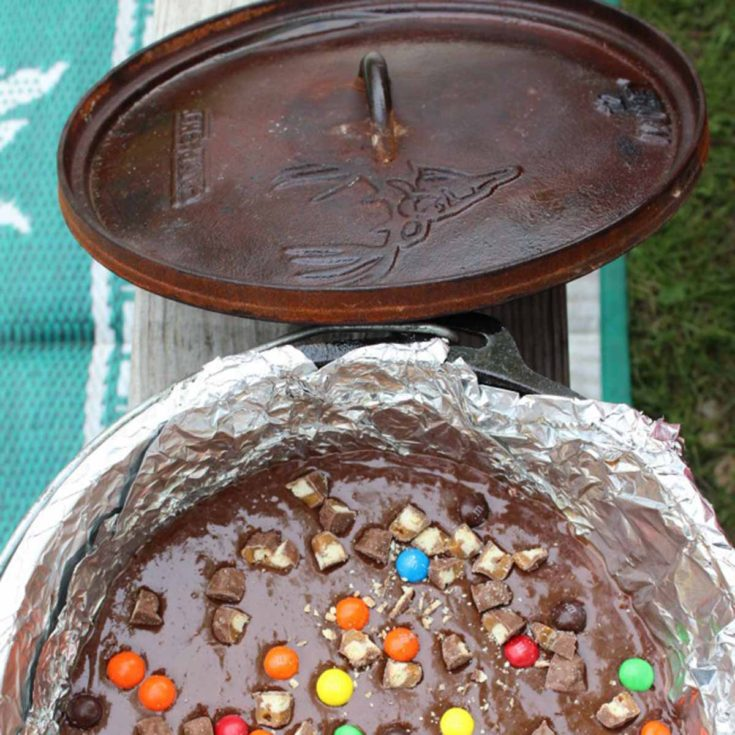 recipe for chocolatey brownies cooked in a dutch oven over a campfire