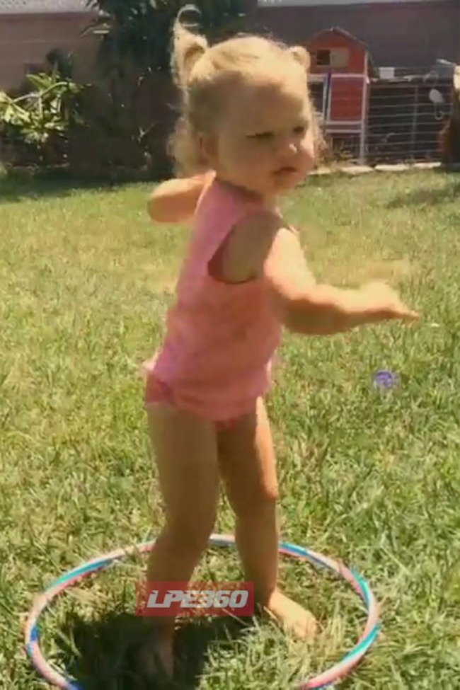 Little Girl Keeps Hula Hooping Even After The Hula Hoop Falls Down