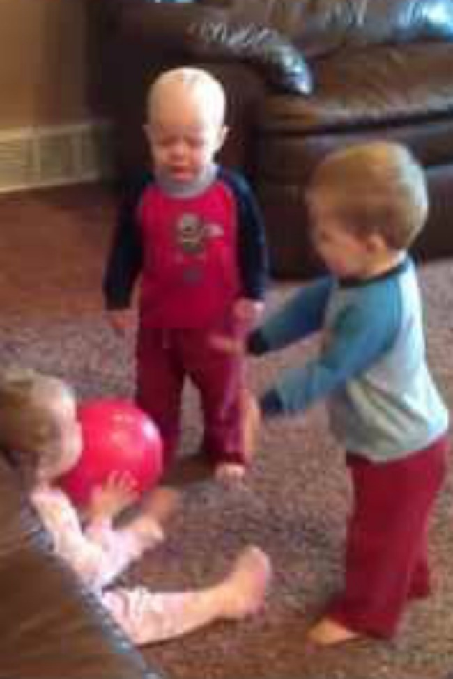 Every Parent Can Relate: These Triplets Are Fighting Over The Same Red Ball