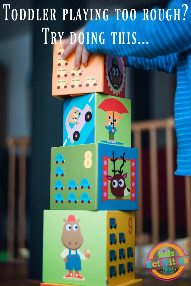 If Your Toddler Is Playing Too Rough - toddler stacking blocks pictured - Kids activities Blog