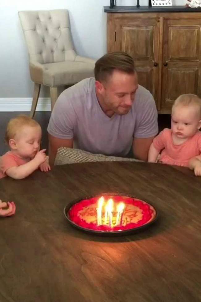 Babies Have Priceless Reaction To Daddy Blowing Out Birthday Candles