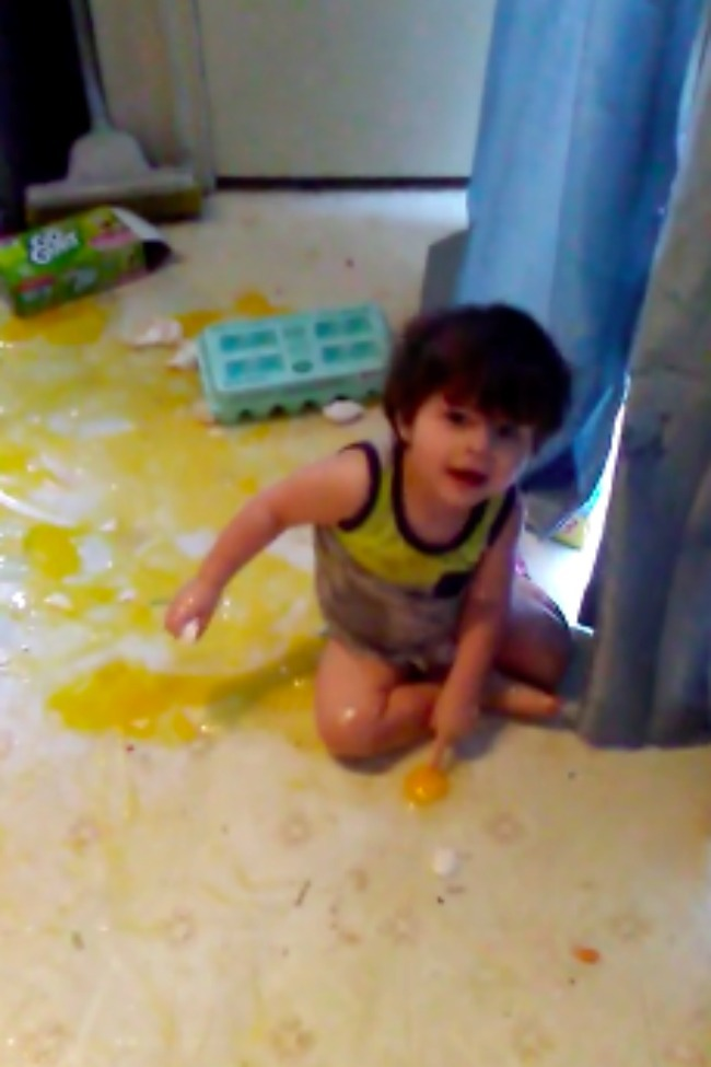 Cute Kid Makes Enormous Mess Out Of Giant Carton Of Eggs