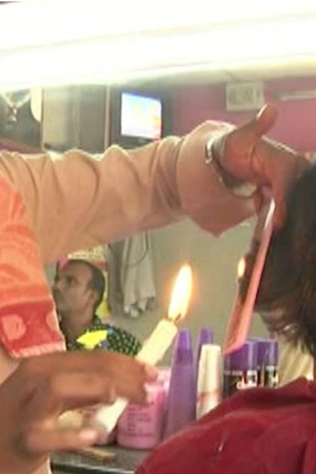 Indian Barber Uses Flames To Cut Hair