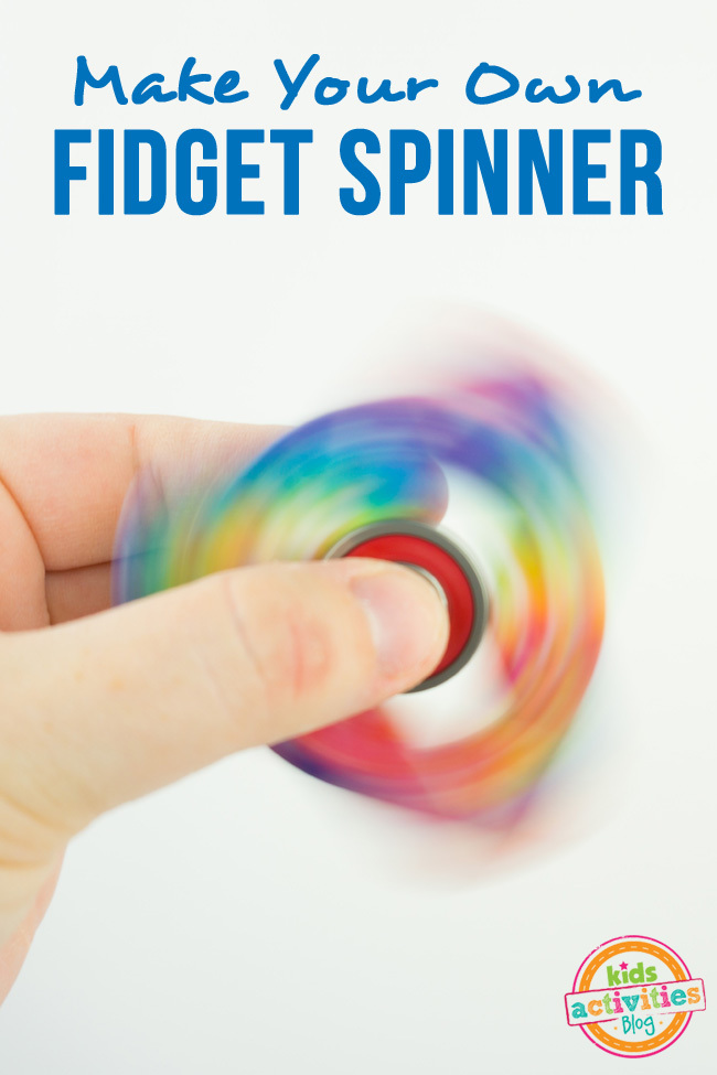 How to Make a Fidget Spinner - make your own DIY fidget spinner craft - fingers holding spinning spinner shown with rainbow colors