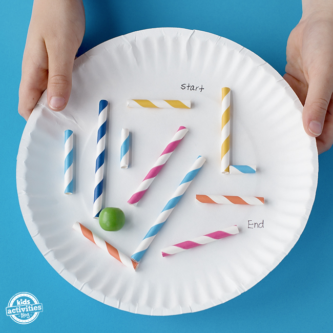 A marble moves through the maze of straws on the paper plate, from start to end.