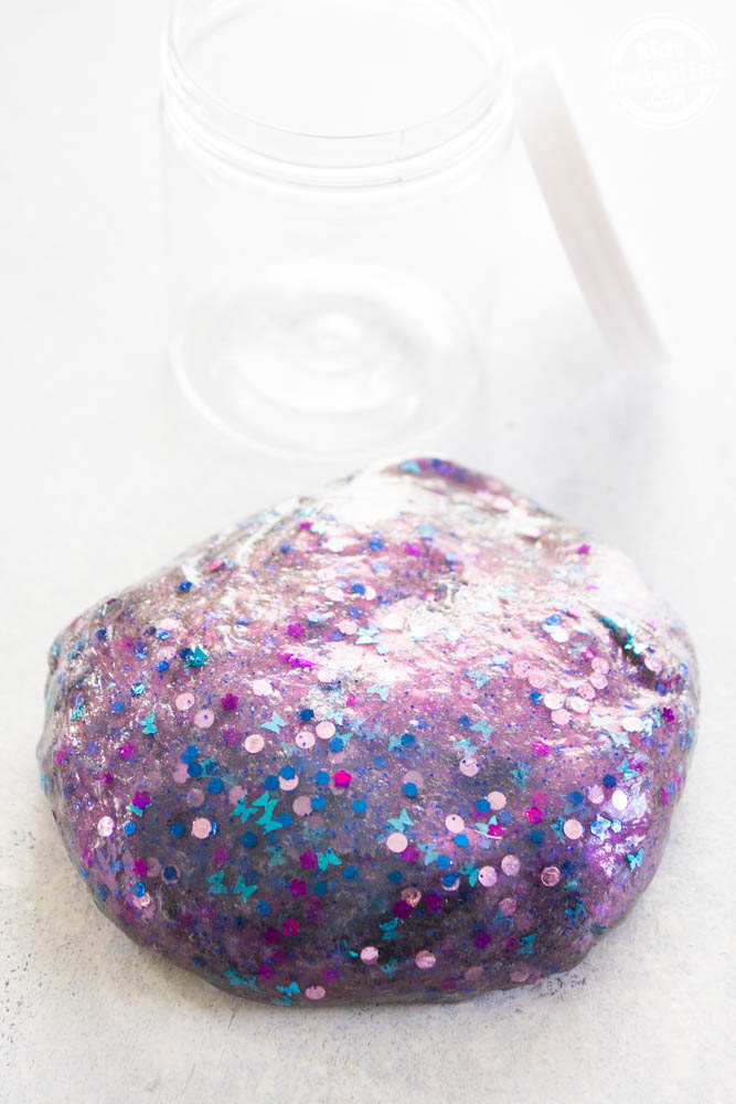 Dragon scale slime that is purple and a fun glitter craft.