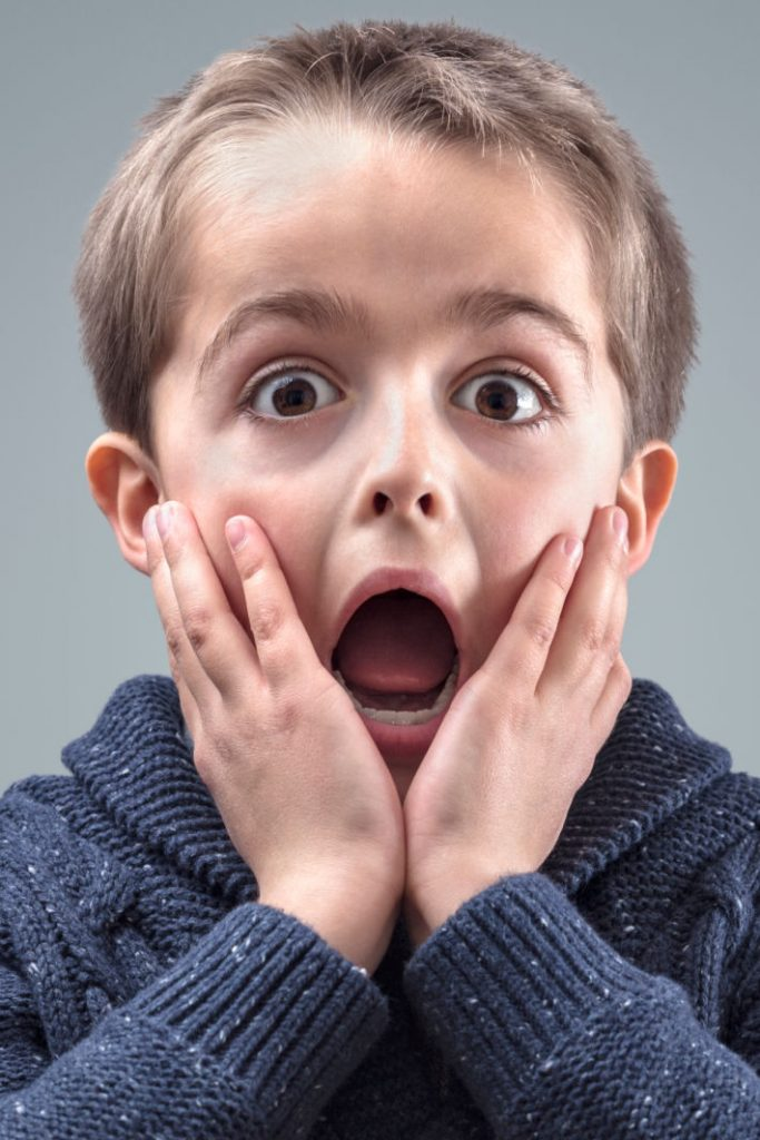 boy reacting to scary story video - Kids Activities Blog