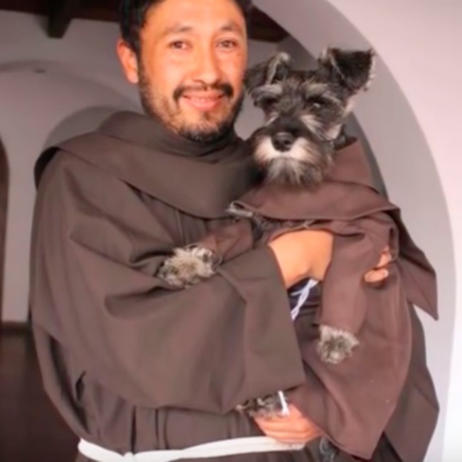 monks - dog and human - screenshot from video about dog adoption into a monastery