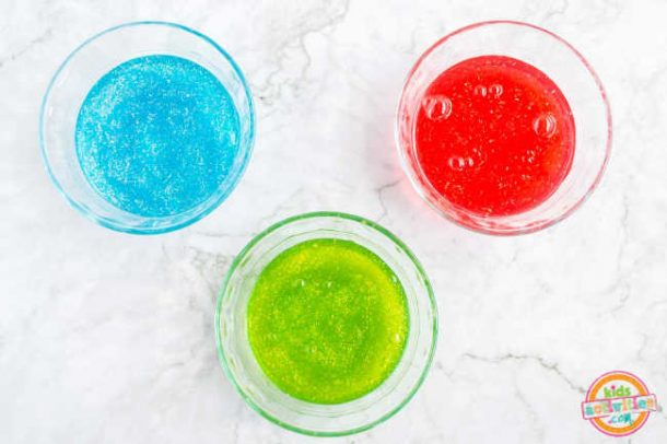 Three bowl of slime made ready to combine to form a rainbow slime recipe.