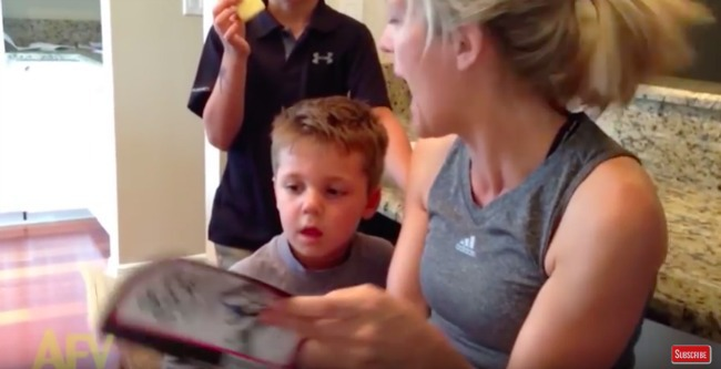 screenshot from video of mom and boy reading together