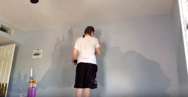 woman painting Harry Potter inspired nursery