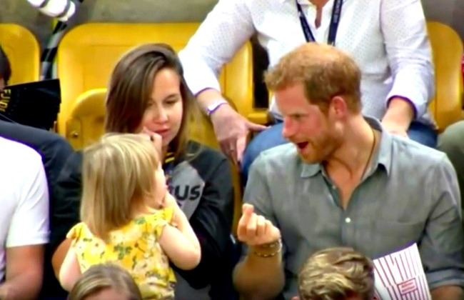 screenshot of Prince Harry being very good natured about his popcorn being stolen