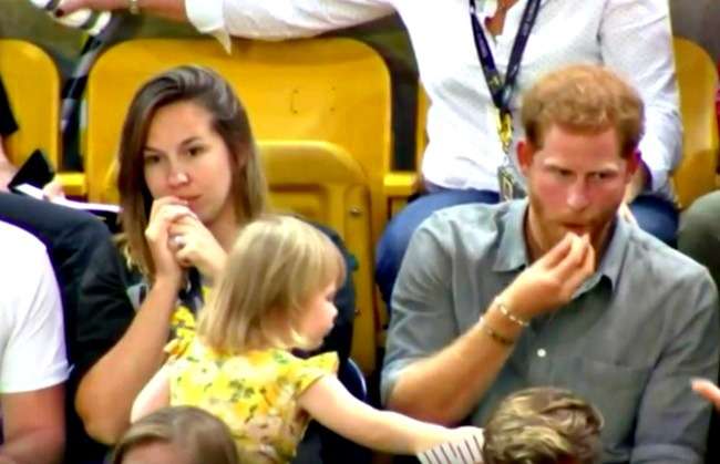 screenshot of girl stealing popcorn from Prince Harry