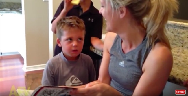 screenshot of video of boy being read a scary story by his mom