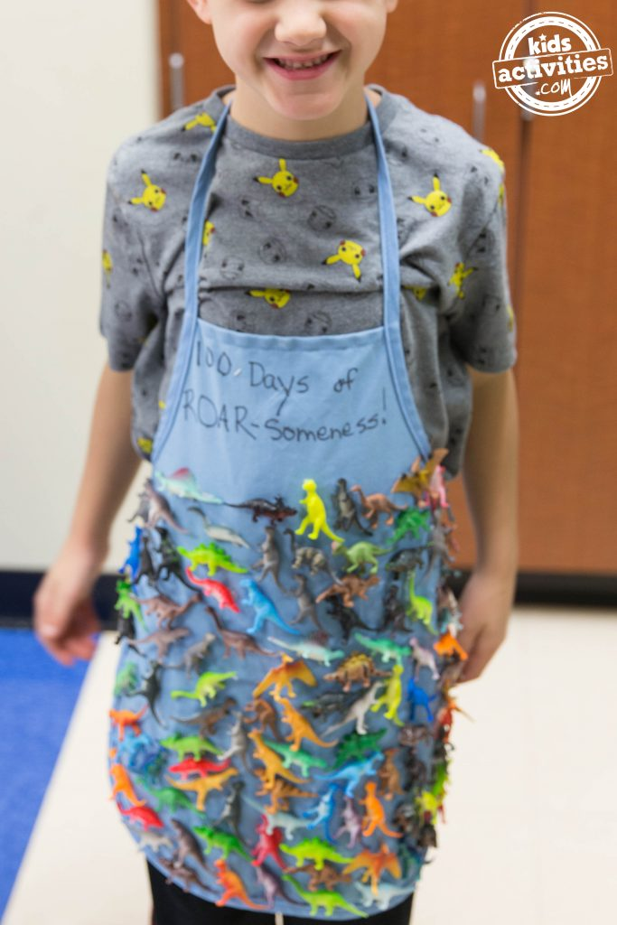 100 days of school shirt from school - apron with 100 dinosaurs attached