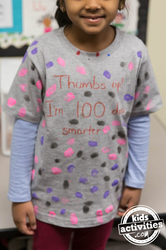 100th Day shirt idea - thumbprints all over the shirt with the tagline Thumbs Up I'm 100 days smarter