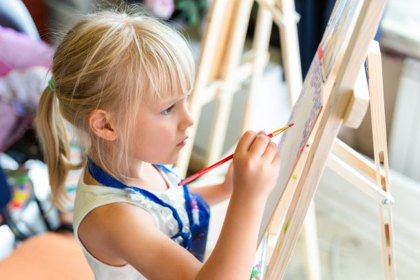 Get active in art by painting with easels.