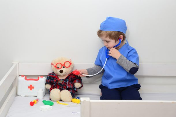 Pretend play by playing doctor or being a vet.