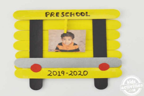 back to school pictures frame is shown with a photo attached to clothes pin in school bus frame - school bus images