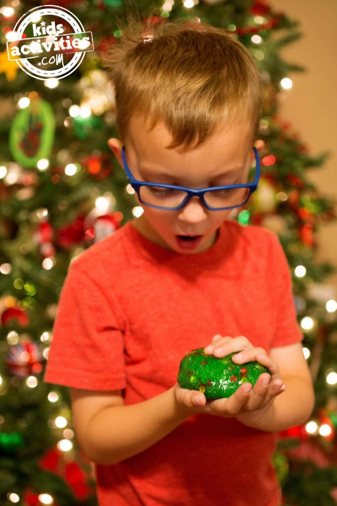 Christmas tree slime - boy playing with it at Christmas