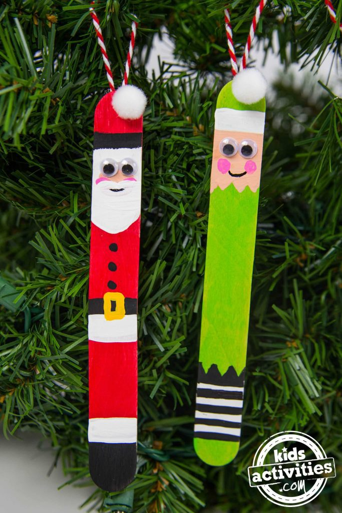 Popsicle stick ornaments that look like santa and an elf.