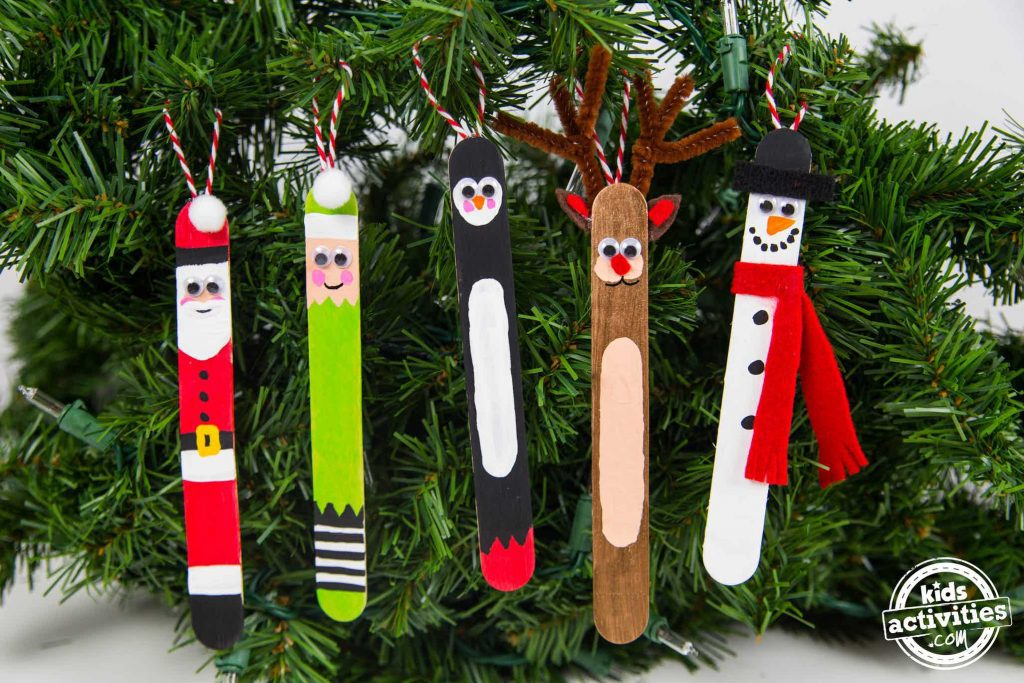 popsicle stick christmas crafts that look great on the christmas tree. The whole gang is there with santa, a green elf, a penguin, Rudolph, and Frosty.