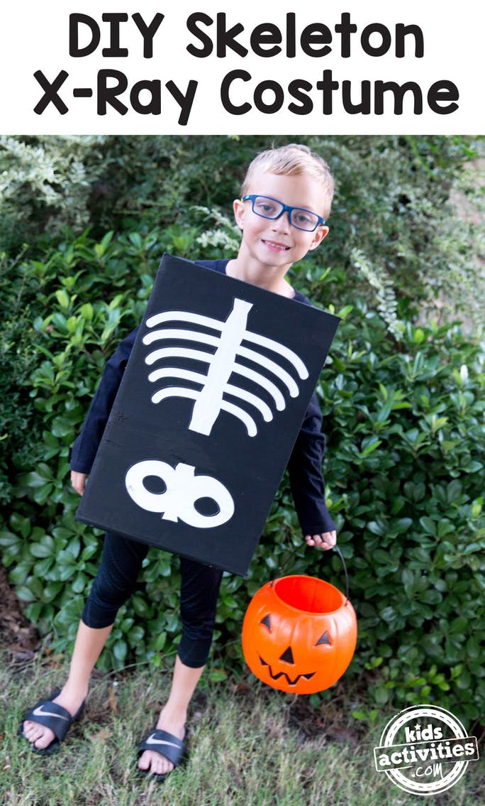 DIY X-Ray Skeleton Costume is super easy to make. As you can see a child is earing a box painted black with a bone spine, ribs, and pelvis painted on it in white.