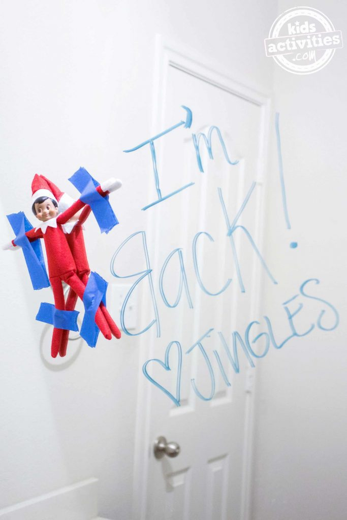 Elf on the Shelf Taped To Mirror
